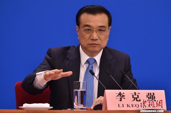 3月15日,���赵嚎�理李克��在北京人民大��堂���中外�者并回答�者提��。 中新社�者 金�T �z