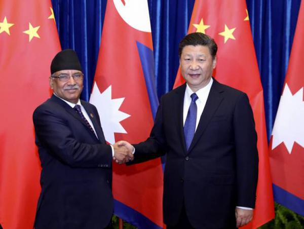 3月27日,国家主席习近平在北京人民大会堂会见尼泊尔总理普拉昌达。新华社记者丁林摄