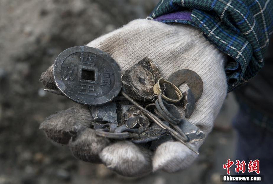 专家认为江口沉银遗址的发现是世界范围内所发现的为数不多的批量宝藏,属于世界级的考古发现,也是定陵之后最重要的明代考古发现。 刘忠俊 摄