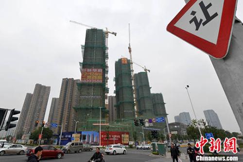 资料图:商品房建设。 中新社记者 吕明 摄