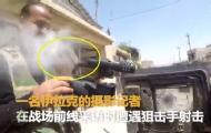 记者胸前摄影机挡狙击枪子弹