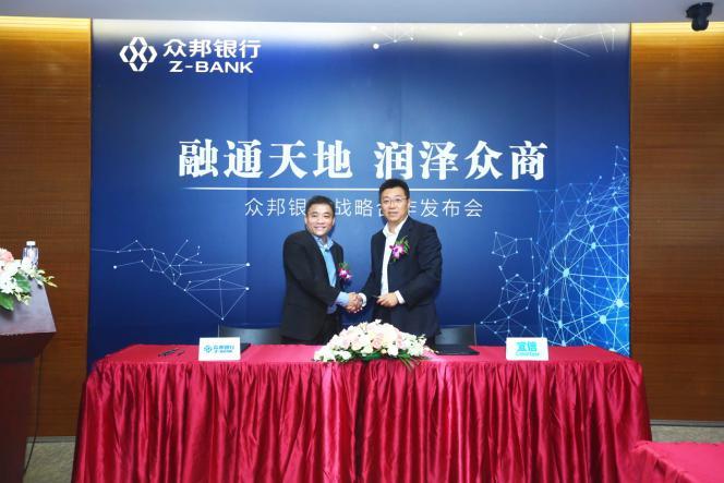 众邦银行副行长李小刚与玖富市场部总监郭子芳。
